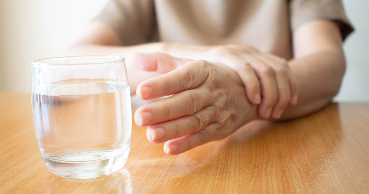 Parkinson's Patient reaching for a Glass